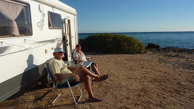 Grey Nomads taking in the view from their Motorhome